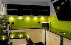 lime green is so unexpected for a kitchen -- i love it! Mine doesn't have quite as much lime green...just a splash back behind the hob.