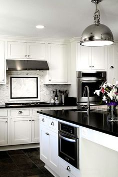 Classic, crisp black & white kitchens are always a winner! Glossy contemporary kitchen in black and white http://planohomesandland.com #realestate #kitchens #homedecor