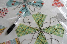what a great idea - transparency over the quilt top to test out quilting ideas