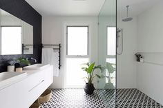 Trendy 3/4 black tile black floor bathroom photo in Sydney with flat-panel cabinets, white cabinets, white walls and a drop-in sink #bathroom #contemporary