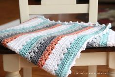 Use this blanket crochet pattern from Daisy Cottage Designs to create a beautiful afghan in any color way.   free crochet pattern, easy crochet pattern, free blanket crochet pattern, granny stripe crochet pattern