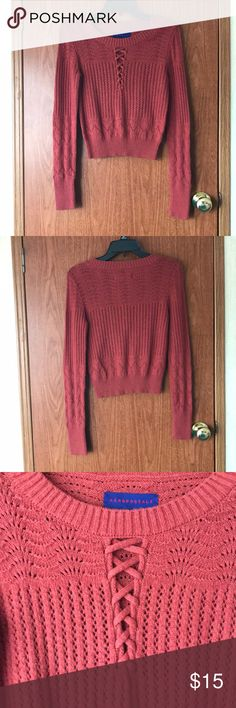 Orange Lace-up Sweater Orange Lace-up Sweater from Aeropostale.  Size M See through details.  Worn once! Minimal pulling, but other than that, no flaws!  Please ask any questions! Offers welcome! All bundles come with an extra discount! Aeropostale Sweaters