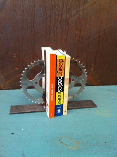 silver metal steel bookends modern industrial decor motorcycle sprocket gears gear atomic decor retro vintage motocross man cave repurposed