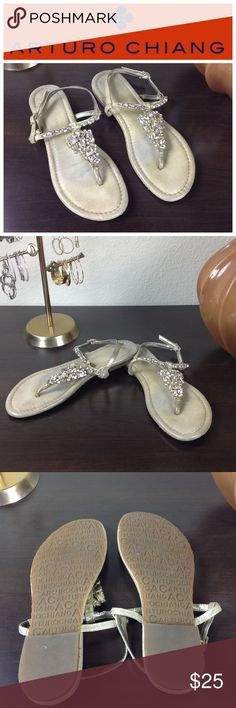 Arturo Chiang Rhinestone Thong Sandals Beautiful brushed gold rhinestone encrusted thong sandals. Shoes are in good condition but are missing a rhinestone on on of the sandals (see pic) but very difficult to see. Thanks for your interest, please take a look at the rest of my closet. Arturo Chiang Shoes Sandals