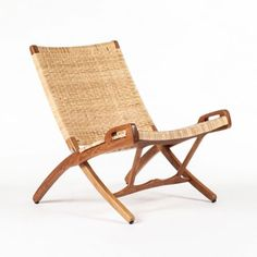 Matthew Izzo offers a wealth of exquisite designer pieces in his online store like this Vilhelm lounger Folding Chair Teak and Rattan.