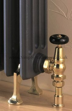 Brass floor supports for cast iron radiators from Simply Radiators.