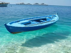 the water is so clear it looks like the boat is floating - imagining this boat in Fiji!