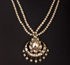 Indian enamel jewelry | strands of pearls with a central carved jade pendant set with diamonds