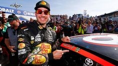 In a race whose aftermath left hometown driver Kyle Busch with a bloody forehead, Martin Truex Jr. passed the faltering car of Brad Keselowski and won Sunday's Kobalt 400.