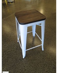 Tolix Barstool replica with wood seat by Cintesi. Powder coated white frame with dark stained wood seat. Large stockholding for commercial projects. Direct import by Cintesi offers you these Tolix replica stools at never seen before prices. Manufactured from steel, fully welded together for superior strength.