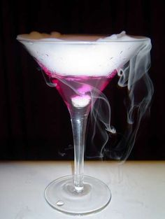 The-Color-Changing-Martini     This drink smokes elegantly, changes from a calm blue to fuschia as it cools from room temperature to drinkably cold, and tastes like a dirty martini.    You'll need:    Gin (or vodka, for a vodka martini) ~ Vermouth ~ Dry Ice ~ Baking Soda ~ Red Cabbage