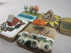 MyLand Sunny Beach, Last Pumpkin, Fall Trees, Christmas Home, Sunflower Inn, and Corn & Wheat puzzles in stoneware by Szilvia Vihriälä of elukka located in Rauma, Finland.