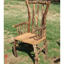 Our very unique Oak & Osage Orange log arm chair.