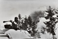 The unique thing about an original photograph is it's ability to capture a moment in time that can never be replicated. *A German soldier is photographed at the moment of throwing a Stg24 stick hand grenade from a Sd.Kfz. 251 — Eastern Front, 1941