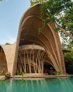 Bamboo architecture is all the rage in the world of tropical sustainable luxury, and the latest word in this trend is the Ulaman Eco Retreat in Bali. This wellness retreat is an incredibly inventive creation that blends ancient building techniques and modern technology to offer an experience of a futuristic village integrated into a tropical forest. #ubudbalihotel #ubudbalihotelboutiques #besthotelsinubudbali #balihoteldesign #balihotelarchitecture Luxury Hotels Bali, Ubud Bali Hotels, Beach Hotels, Hotels And Resorts, Luxury Travel, Best Of Bali, Bamboo Architecture, Ancient Buildings, Tropical Forest