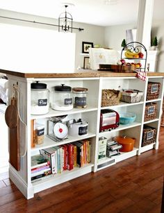 Bookshelves Turned Kitchen Island IKEA Hack The IKEA Billy Bookcase was used for this GENIUS hack… It was created as a room divider and uses an IKEA butcher block for the top surface!… I need to calm down! Kitchen Island Ikea Hack, Kitchen Island Storage, Kitchen Ikea, Kitchen Hacks, Kitchen Islands, Kitchen Organization, Organization Ideas, Kitchen Counters, Room Kitchen