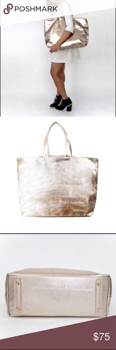 """Metallic Gold Carryall tote  Glamorous and spacious Carryall fits comfortably over the shoulder and adds timeless style to your look. It's a modern take on the Everyday bag - designed in a more structure and refined silhouette ❤️  Height: 13.5"""" Width: 20.5"""" Depth: 6.5"""" 4 inner patch pockets D-ring on the side for clipping key rings Inner strap closure with swivel snap 100% cotton canvas 100% nylon lining Thursday Friday Bags Totes"""