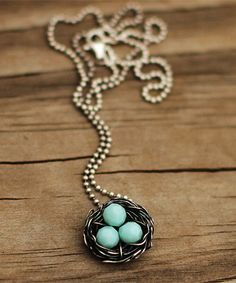 messy nest necklace with aqua eggs as a keepsake for mom $41 - each stone represents one child; would make a great Mother's Day gift!