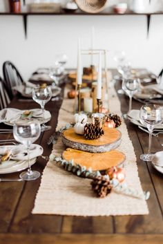 Set the stage for a rustic, elegant Thanksgiving table! If you're hosting the holidays at your house, you can look to this simple table for ideas on how to decorate your table.