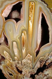 """Agate    """"The quartz crystals in agate is said to be cryptocrystalline - which means that it has a crystalline structure so fine that no distinct particles are recognizeable by the naked eye, nor under the microscope, with regular magnification."""""""