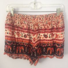 Printed Flowy Shorts adorable red/orange printed flowy shorts from the brand Angie! second picture shows pattern! Brandy Melville Shorts