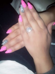 Pink tribal stiletto nails