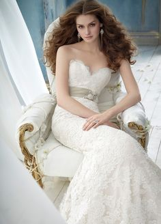 Jim Hjelm Ivory Alencon Lace over Champagne Charmeuse modified A-line bridal gown, strapless sweetheart neckline, Champagne moire ribbon with crystal applique, sweep train.