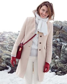 To create an outfit for lunch with friends at the weekend pair a nude coat with white slim jeans. Shop this look for $72: http://lookastic.com/women/looks/skinny-jeans-gloves-crossbody-bag-scarf-cable-sweater-coat/6729 — White Skinny Jeans — Red Leather Gloves — Red Leather Crossbody Bag — White Scarf — Grey Cable Sweater — Beige Coat
