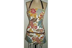 You can make this darling apron in less time than it takes to whip up an omelette, and you can use cute vintage linen napkins or brand-new ones from a home decor shop.