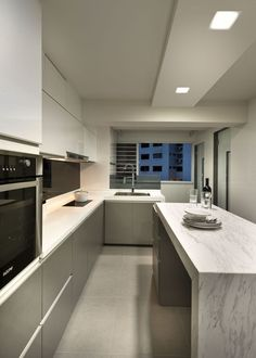 sleek and modern kitchen design with no handles visible