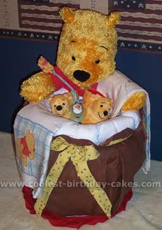 Pooh Bear Diaper Cake... This website is the Pinterest of diaper cake ideas