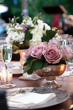 Lovely garden flower mixed table centres with the Amnesia rose pulling the dusk colour palette together different colors though
