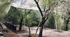 Mexican architects Tatiana Bilbao has used mirrored glass, rammed earth, and clay bricks, to create this holiday home in a forested hillside in Monterrey, Mexico. House Of Mirrors, Bilbao, Modern Glass House, Glass House Design, Green Architecture, Residential Architecture, Innovative Architecture, Architecture Interiors, Beautiful Architecture