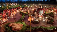 """Shanghai Disneyland: Alice in Wonderland Maze is the first attraction at a Disney park to focus on Tim Burton's """"Alice in Wonderland"""" film. Guests have to make their way through sculpted hedges, stone garden walls, giant flowers and sculptures to get to the Mad Hatter's Tea Party."""