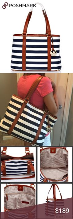 """✨MICHAEL KORS striped tote % AUTHENTIC MICHAEL KORS large east/west tote.  Model #35S4GSUT3R.  Beautiful Canvas in Navy/White. Leather in brown luggage color. Gold tone hardware. Interior features MK Signature Lining with 4 slip pockets and one large zip pocket.  Also one exterior slip pocket perfect for a cell phone on the back side.  Snap closure.  Measures 14""""L x 10.5""""H x 5""""D.  Bag was only carried a few times - shows minor signs of wear along bottom (see last photo).  Otherwise in great…"""