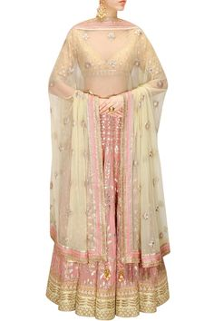 This Pinkish Peach color Bridal Lehenga Choli is featuring georgette fabric embellished with traditional gota patti embroidery in floral pattern. This Pinkish