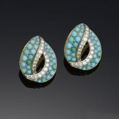A pair of turquoise and diamond earclips, by Cartier,