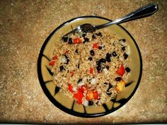 I made the recipe up over the years and call it Fiesta Rice. You mix together 1 1/3 cup cooked, warm brown rice, 1/2 cup black beans, 1 small tomato, a couple tablespoons of onion, garlic salt, pepper, cumin, and the most important ingredient, fresh lime juice. Lime juice is what makes this dish. You can also add fresh garlic and chicken if you want to. Red Wine Vinegar also tastes GREAT in this dish. The whole entire recipe comes to just around 400 calories! And that is a lot of food…