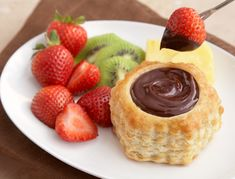 Chocolate Fondue Cups from Campbell's Kitchen . Sharing isn't necessary when you fill individual puff pastry shells with this exquisite chocolate fondue. Serve with fresh fruit and everyone can enjoy their own dessert. Mini Desserts, Just Desserts, Delicious Desserts, Dessert Recipes, Yummy Food, Fondue Recipes, Health Desserts, Yummy Recipes, Profiteroles