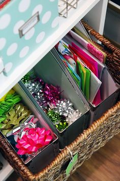 Organising paper and bows with magazine files in large wicker basket