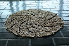 This Leisure Arts Doily Rug was crocheted with about 50 recycled Kroger plastic bags. Pattern available for sale at Leisure Arts, Inc.