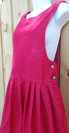This listing is for a phenomenal 100% cotton denim dress jumper by Woolrich! The sun was playing with me outside, so please note the color is red and not the darkish pink my photos show. The jumper comes in excellent pre-owned condition with no flaws noted. I washed it and hung it to dry. The size tag says a small, but due to the loose fitting nature of the dress/jumper, it can possibly fit a larger size.  Be sure to review the measurements to see if it will fit you. Measurements are as ...