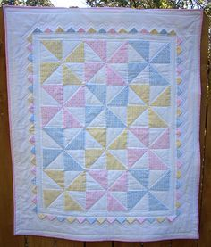 Pastel pinwheel quilt with prairie points.