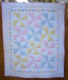 Pastel pinwheel quilt with prairie points.