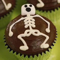 """Love these for our party, too! Chocolate iced cupcakes: simple, and just follow the design in the pic to create professional looking 'x-ray' results! Use a ziplock bag, snip the end, fill with white icing, decorate. Viola! All your friends will ask, """"Who made the cute cupcakes?"""""""