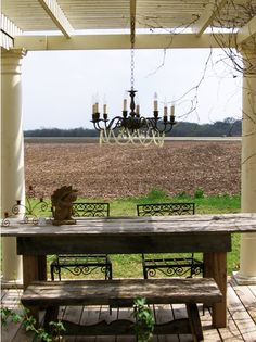 love the pergola and reclaimed wood table
