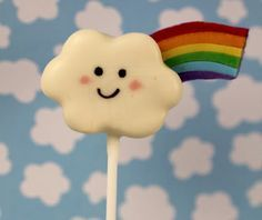 """Happy Rainbow cloud cake pops - from the fabulous Bubble and Sweet blog, with step to step explanation how to make cloud + rainbow (she even has a cake pop book """"Sweets on a Stick"""")"""