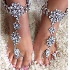 "Beach Wedding Barefoot Sandals Jeweled with Crystals and Rhinestones. This Ankle Foot Bracelet Set has a Crystal Flower Design with Silver Chains on The Crystal Rhinestone Barefoot Sandal One Pair Coordinating Hand Chain Available One size fits ""most"" Women. Handmade upon Order Chain is Adjustable: 32 - 39cm Toe Chain is 25cm Please be sure to measure around your ankle to be sure the size is appropriate for you."
