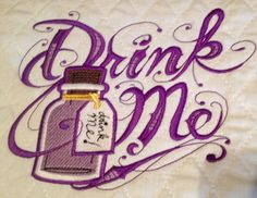 Drink Me embroidered baby pad - Alice in Wonderland