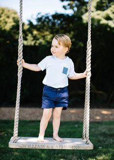 Prince George (3) on a swing at Sandringham dedicated to William and Catherine.